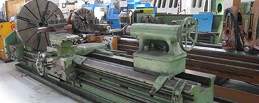 Sliding bed lathes
